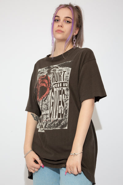 Faded black, single-stitch tee with a print of 'Hurt 'Till It Gives' and a ball on the front. Severe distressing and a baggy fit make this a vintage must-have.