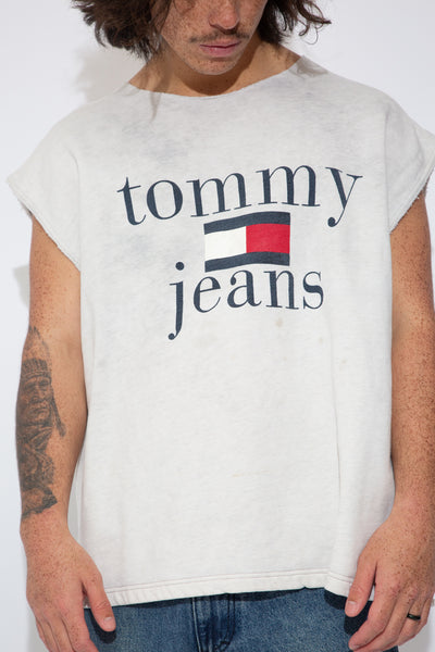 grey raw cut sweater vest with bootleg tommy jeans graphic on front