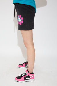 Black sweat shorts with a colourful print of Mickey Mouse on a flower on the left leg and an elasticated waist.
