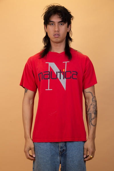 the model is wearing a nautica tee with a massive hit on the front chest of the logo