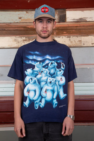 navy tee with front and back graphic of polar bears drinking coke watching the northern lights