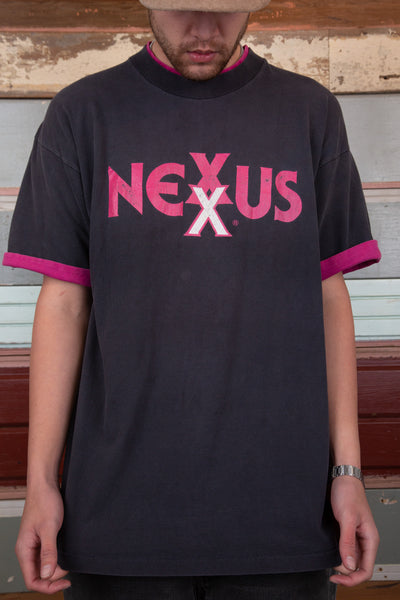 distressed faded black tee with magenta pink contrast detailing on neckline, sleeves and spell-out