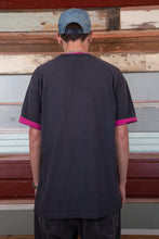 Load image into Gallery viewer, distressed faded black tee with magenta pink contrast detailing on neckline, sleeves and spell-out