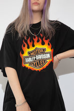 Load image into Gallery viewer, Black Harley Davidson tee with a flaming Harley Davidson Motorcycles logo on the front.