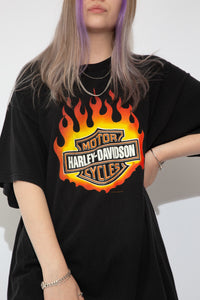 Black Harley Davidson tee with a flaming Harley Davidson Motorcycles logo on the front.