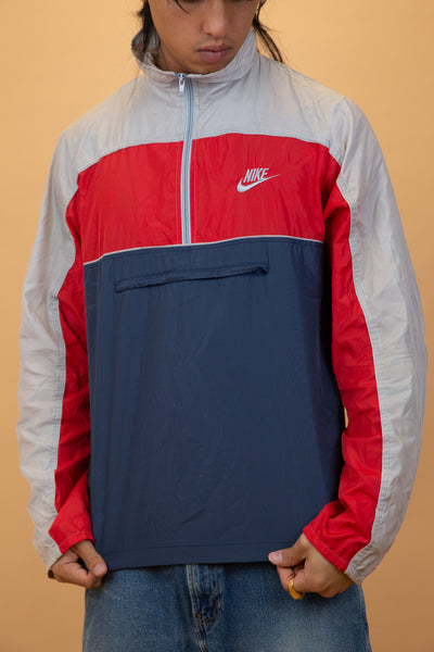 nike windbreaker in a red navy and grey colour-way. 90s vintage. magichollow.