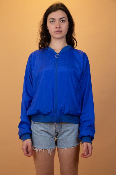 blue bomber style jacket with a zip-up front
