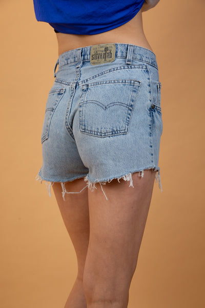 light-washed levi's silvertab denim jeans with a frayed bottom.