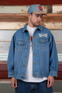 mid/dark-wash denim jacket with embroidered mickey patch detailing on back and left chest