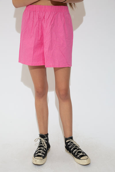 These shorts are a high-waisted style, in a linen-like material and are, of course, bright watermelon pink. Have a baggy fit and an adjustable waistband.