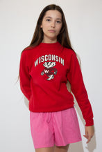 Load image into Gallery viewer,  Red in colour with a large print of the university's mascot, Bucky Badger, on the front and a 'Wisconsin' capitalised spell-out above