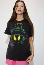 Load image into Gallery viewer, Black in colour with a large print of Marvin the Martian's face on the front in green, blue, pink and yellow.