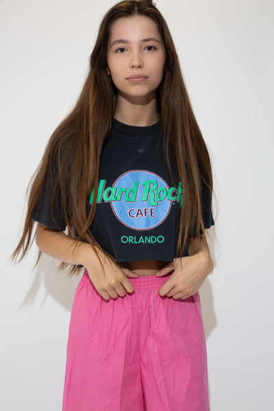 Black in colour with a retro style, single stitching and the Hard Rock Cafe logo in purple, pink and mint green. Repping Orlando, Florida in a cute, cropped style