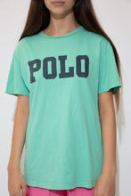 Load image into Gallery viewer, Mint green tee with a large capitalised Polo spell-out across front in navy blue. The stretched out neckline adds to the baggy fit.