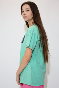 Mint green tee with a large capitalised Polo spell-out across front in navy blue. The stretched out neckline adds to the baggy fit.