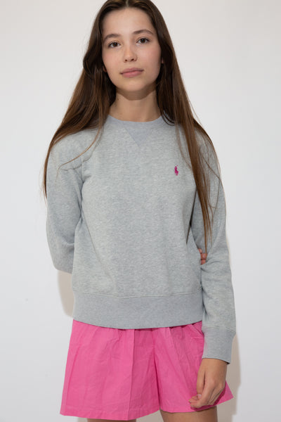 Grey in colour with a crewneck style and pink embroidered Ralph Lauren logo on the left chest.