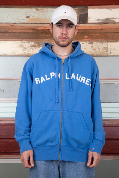 blue zip-up sweater with white ralph lauren spell-out across chest