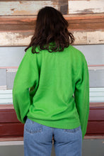 Load image into Gallery viewer, the model is wearing a green knitted sweater made from lacoste, this sweater fits oversized.