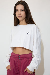 This white tee has a dark blue embroidered Ralph Lauren logo on the left chest and a stretched out neckline, adding to the baggy fit. Cropped to keep it cute.