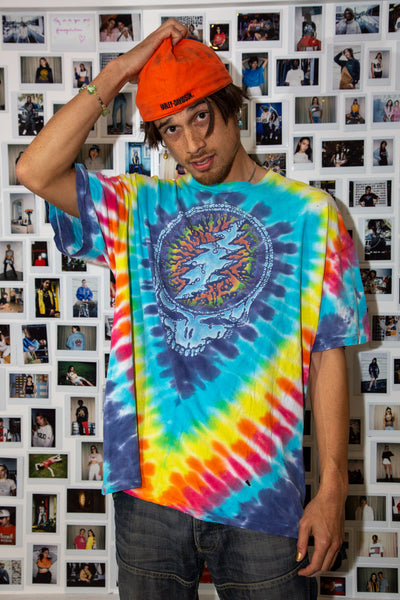 Multi-coloured tie-dye tee with a large abstract skull print. On the back, A circular grateful dead summer tour' spell-out, dated 1995.