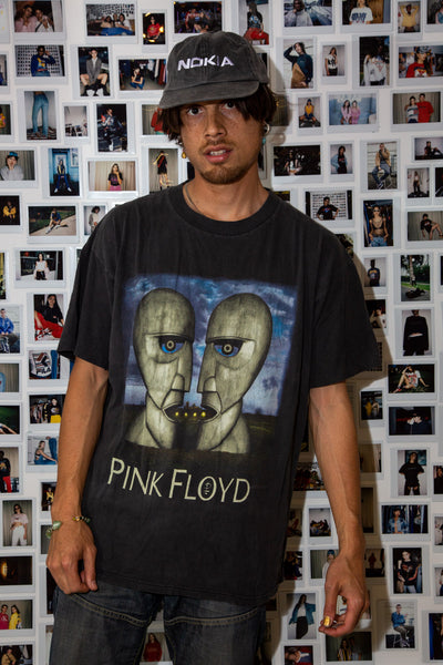 faded black tee with the division bell album cover on the front and a pink Floyd spell-out. On the back, a list of tour locations, dated 1994 at the bottom.