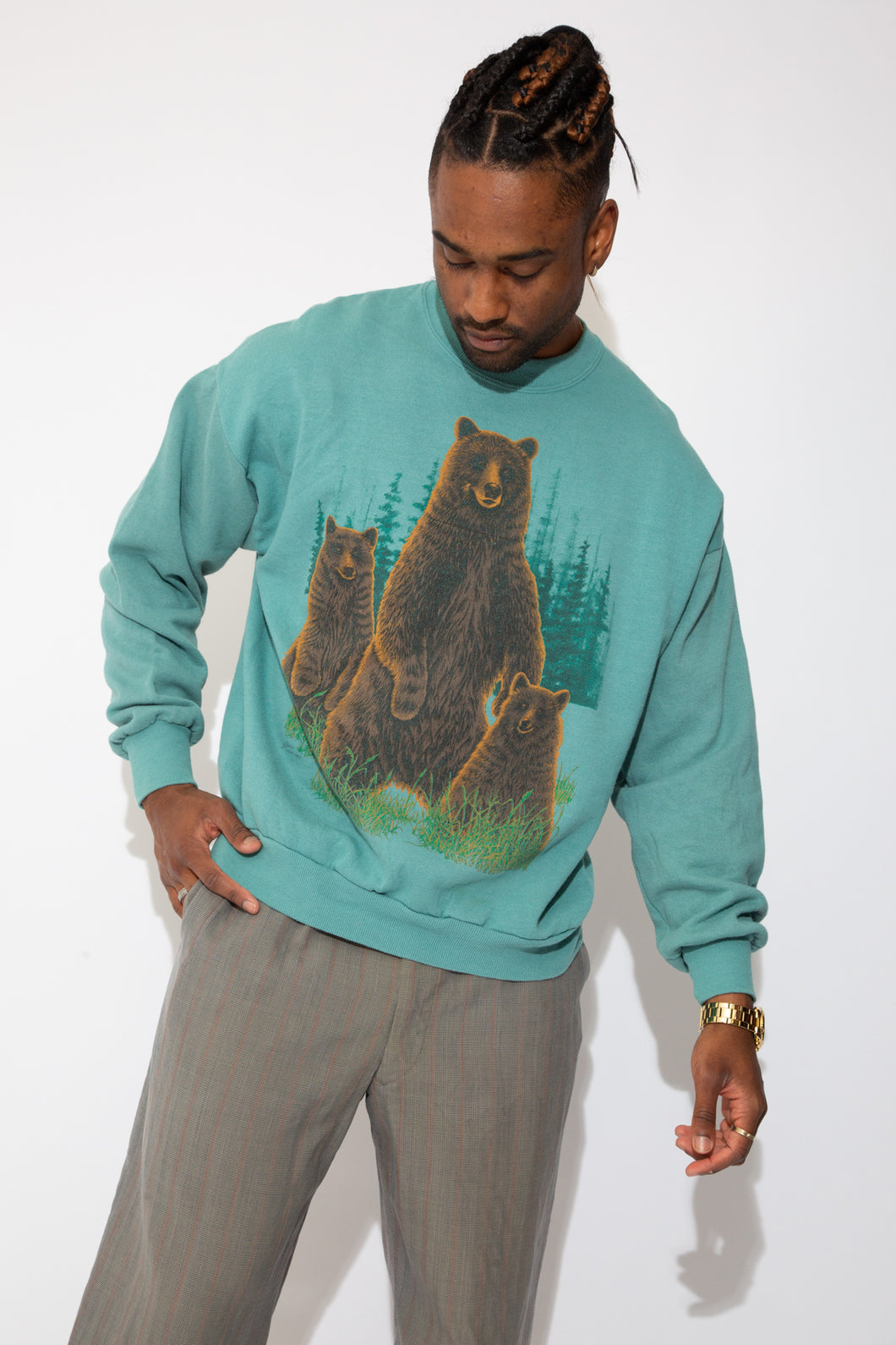soft teal sweater in boxy fit with bear graphic on front