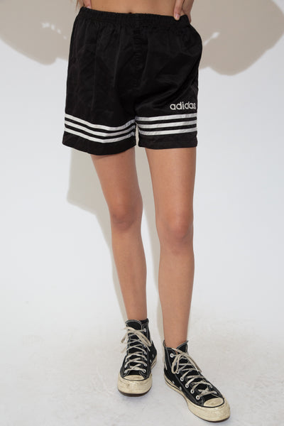 Black athletic shorts with the signature three stripes across the bottoms and an Adidas embroidered spellout on the left leg. Has an adjustable waistline.