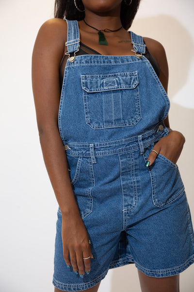 The model is wearing a pair of vintage short dungarees made by Arizona denim