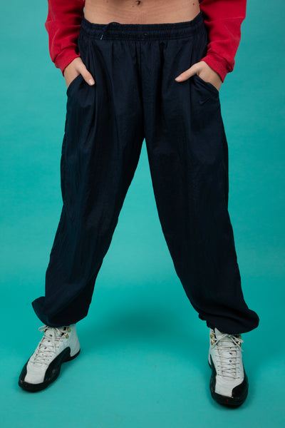 model wearing Nike track pants, magichollow