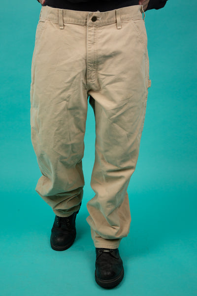 Tan/beige vintage pants in a straight-cut fit. magichollow