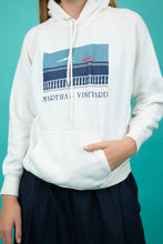 "Load image into Gallery viewer, White hoodie with ""Martha's Vineyard' and an abstract print across the chest.  Finished off with a kangaroo-pouch pocket and draw strings around the neck, for that comfy fit."
