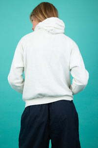 "White hoodie with ""Martha's Vineyard' and an abstract print across the chest.  Finished off with a kangaroo-pouch pocket and draw strings around the neck, for that comfy fit."