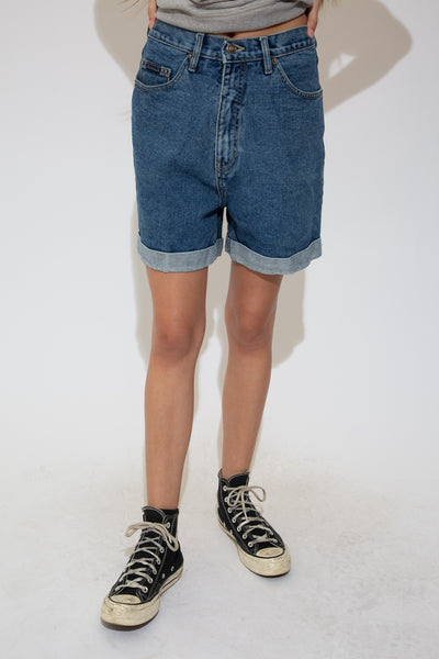 These must-have shorts are a mid-wash blue with a relaxed fit, foldable bottoms, light brown stitching and branding on the back waistline, front pocket and button.