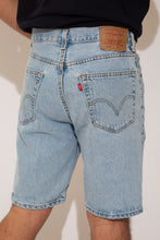 Load image into Gallery viewer, levi's denim shorts. 90s vintage. magichollow.