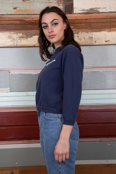 model wearing Champion sweater, magichollow
