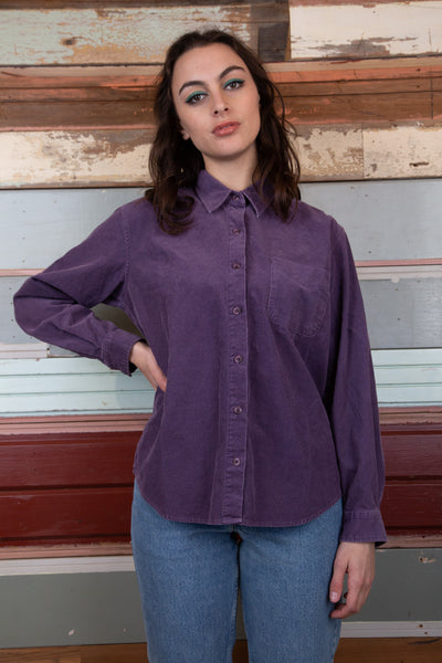model is wearing a purple corduroy button up that is made by columbia.