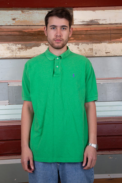 vibrant green polo with embroidered ralph lauren emblem on left chest