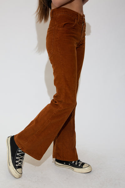 Brown in colour with a corduroy feel, flared legs and branding on the back pocket and buttons.