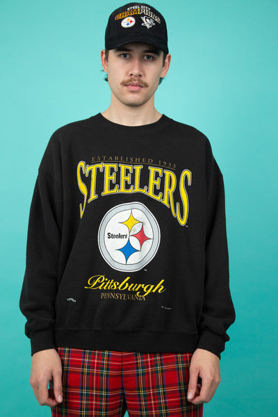 black oversized sweater with steelers logo and spell-out across chest