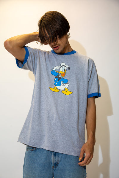 This grey tee is in a ringer style with a blue neckline and sleeves. Finished off with a large Donald Duck print on the front.