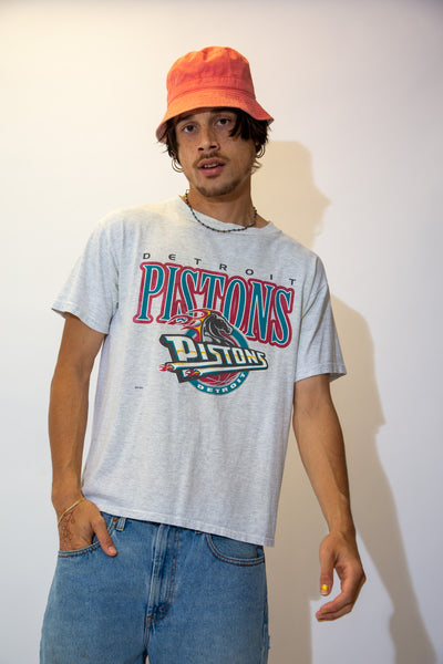 Grey in colour with a large Detroit Pistons print across the front and the logo below
