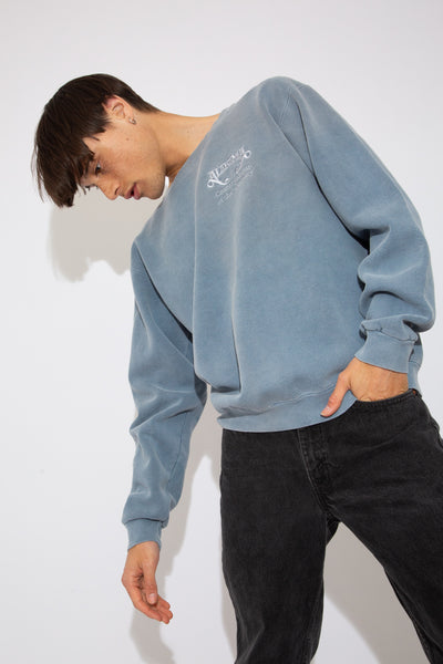 faded blue crewneck with embroidered alabama text on left chest