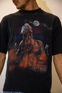Black in colour with a large colour print of horses running in the moonlight, this tee is vibing with some elevated shit. Dated 1993 below.