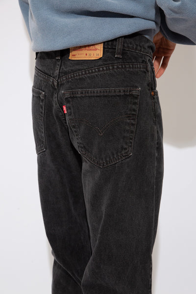 faded black baggy to tapered jeans
