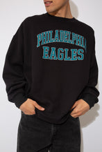Load image into Gallery viewer, black crewneck with teal and silver 'philadelphia eagles' spell-out across chest