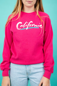 Model wearing pink California sweater, magichollow
