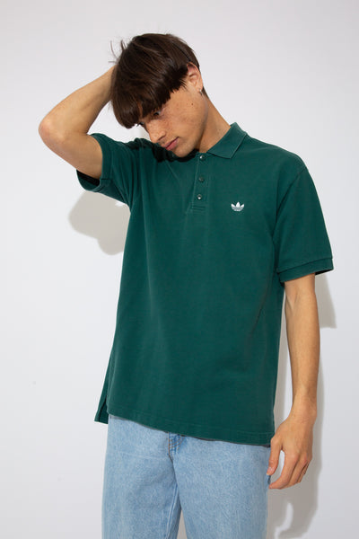 dark green polo with white embroidered adidas trefoil emblem on left chest - 90s vintage - magichollow
