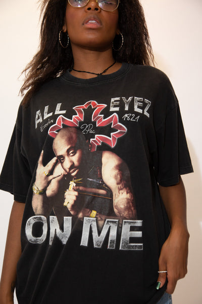 "Black in colour with a large print of 2Pac himself and 'All Eyez On Me"" printed across in capitalised letters."