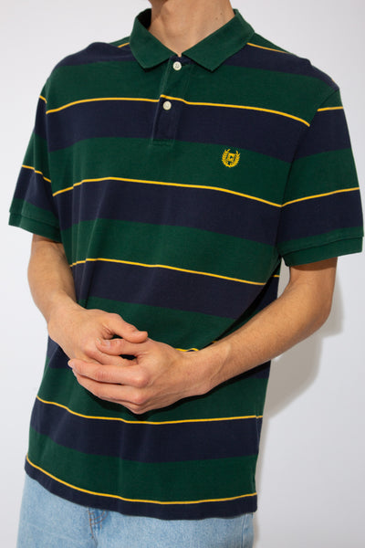 green and navy striped polo with yellow stripe accents and embroidered chaps logo on chest