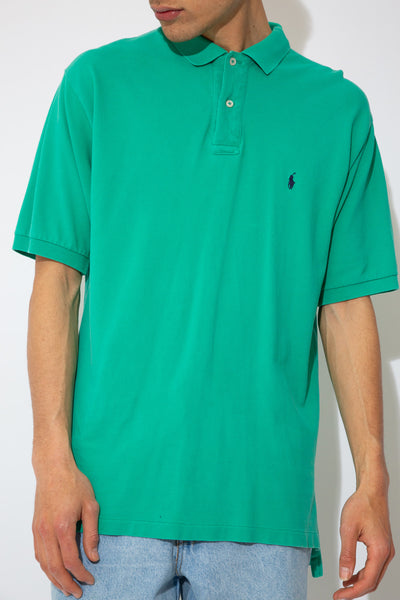 teal  short-sleeved polo with embroidered ralph lauren logo on left chest